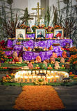 Day of the dead altar with pan de muerto and candles Royalty Free Stock Images