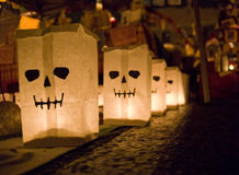 Day of the dead bags. Day of the dead holiday in Latin or Hispanic tradition. Paper bags with skeletons painted on them Stock Photo