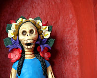 Day of the dead Catrina. Mexico's traditional day of the dead Catrina close up with flowers on head Stock Photo