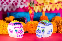 Sugar skull and mexican marigold flower - Day of the dead celebration stock photography