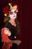 Day of The Dead Child with Doll Royalty Free Stock Photography