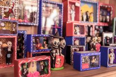 Day of the dead couple figurines on the shelf stock image
