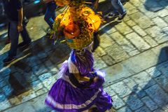 Day of the Dead Dancer. A woman dances in a street parade during Day of the Dead celebrations in Oaxaca, Mexico royalty free stock photo