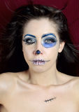 Day of the dead. Detail view of young girl with scary makeup Royalty Free Stock Image