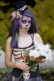 Day of the Dead Goth Girl. Woman with painted face for Dia De Los Meurtos and purple hair Stock Images