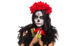 Day of the dead. Halloween. Young woman in day of the dead mask skull face art and rose. on white. closeup. stock image