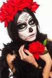 Day of the dead. Halloween. Young woman in day of the dead mask skull face art and rose. Isolated on white. closeup. Young woman in day of the dead mask skull royalty free stock photo