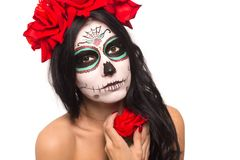 Day of the dead. Halloween. Young woman in day of the dead mask skull face art and rose. Isolated on white. closeup. Young woman in day of the dead mask skull stock images