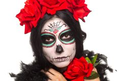 Day of the dead. Halloween. Young woman in day of the dead mask skull face art and rose. Isolated on white. closeup. stock photo