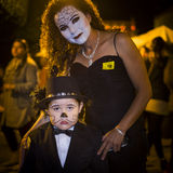 Day of the Dead, Mexico. The day before Halloween, a mother and son, with face make-up in traditional Catrina (death) style, participate in the Catrina parade in stock photos