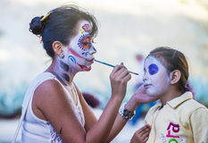 Day of the Dead. OAXACA , MEXICO - NOV 02 : Unidentified participant has his face covered with makeup on a carnival of the Day of the Dead in Oaxaca, Mexico on royalty free stock photo