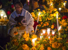 Day of the Dead. OAXACA , MEXICO - NOV 02 : Unidentified people on a cemetery during Day of the Dead in Oaxaca, Mexico on November 02 2015. The Day of the Dead royalty free stock photo