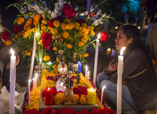Day of the Dead. OAXACA , MEXICO - NOV 02 : Unidentified woman on a cemetery during Day of the Dead in Oaxaca, Mexico on November 02 2015. The Day of the Dead is stock photography