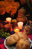 Day of the dead offering altar (Dia de Muertos). Offering altar as part of the celebration of the day of the dead in Mexico (Dia de Muertos) with bread Pan de Stock Photo