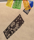Day of Dead Papel Picado against Stucco Wall Stock Photo