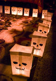 Day of the dead paper bags. Day of the dead holiday in Latin or Hispanic tradition. Skeleton painted on paper bags lit with candles Stock Photos