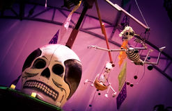Day of the dead Skeleton. Day of the dead holiday in Latin or Hispanic tradition.  Skeletons flying over a skull Stock Photography