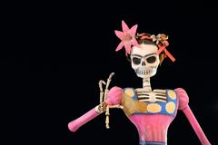 Day of the dead skeleton puppet against black background stock photo