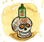 Day of the dead skull. A day of the dead skull painted with a bottle of alcohol on top Stock Images