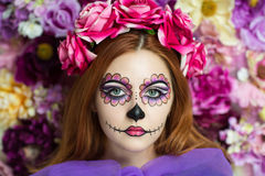 Day of the Dead. Skull Mask. Art woman beautiful face painted as a traditional , pink flowers on head. Free place on photo for congratulations. Good for stock photos