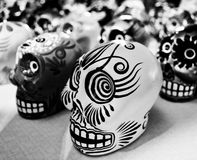 Day of the dead skulls. Day of the dead holiday in Latin or Hispanic tradition. Candy skull heads in a black and white image Stock Images