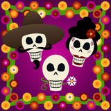 Day of the Dead Skulls. Three festive skulls celebrate Dia de los Muertos (the Day of the Dead, Oct.31-Nov2) - surrounded by colorful carnations Stock Illustration