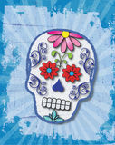 Day of the Dead Slightly Grungy Sugar Skull. Bright Sugar Skull design with blue grunge background Royalty Free Stock Image