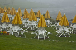 Day is Done. This was the end of a summer day and the tables and chairs are resting on the umbrella tables Royalty Free Stock Photography