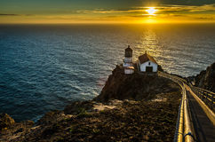 Day is Done. Point Reyes Lighthouse with sunset reflection on the ocean Royalty Free Stock Photos