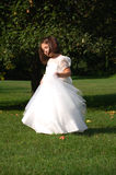 Day Dreamer. Four year old flower girl dancing outside Stock Image