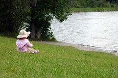 Day dreaming. Child enjoying the lake view ,British Columbia, Canada Royalty Free Stock Photography
