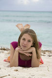Day Dreaming. Teenage girl day dreaming on beach stock photo