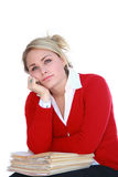 Day Dreaming. Pretty blonde office worker day dreaming over a stack of files Royalty Free Stock Images
