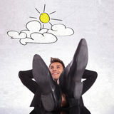 Day dreaming business man relaxing. And waiting for sunny days royalty free stock image