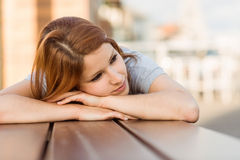 Day dreaming casual redhead lying on bench Royalty Free Stock Photo
