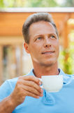 Day dreaming with cup of coffee. Royalty Free Stock Photography