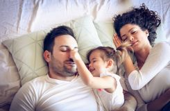 Day dreaming. Family in bed. stock photos