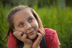 Day dreaming girl. Portrait of a young girl day dreaming in nature stock images