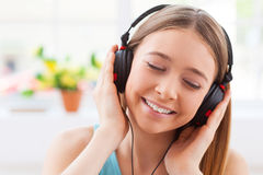 Day dreaming with her favorite music. Stock Images