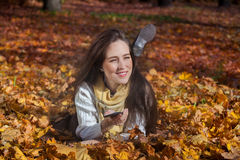 Day dreaming with music in autumn. Royalty Free Stock Images