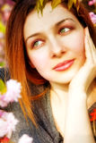 Day dreaming pensive woman and spring flowers Stock Photography