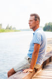 Day dreaming on riverbank. Royalty Free Stock Photography