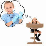 Day Dreaming Student. Adorable 7 year old american girl in school desk dreaming about becoming a surgeon over white background