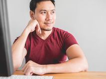 Day dreaming at work. Asian man not concentrate his work. Dreaming for something else Royalty Free Stock Photo