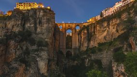 Ronda Puente Nuevo. Day and dusk to night of the popular historic landmark of spectacular Puente Nuevo, New Bridge at sunset, over Guadalevin River in Ronda town stock photo