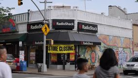 Day Establishing Shot of a Closing Radio Shack in Brooklyn. 8700 BROOKLYN - Circa June, 2017 - A daytime establishing shot of a closing Radio Shack in downtown