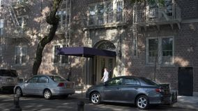 Day Establishing Shot of Upscale Apartment Building in Brooklyn. 8668 A daytime exterior establishing shot of the front entrance to an upscale apartment building stock footage
