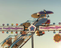 Day at the fair. Detail of classic amusement park ride with stylized subtle vintage look and feel Stock Images