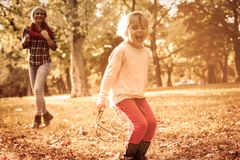 Day full of laughter. Little girl with her mother playing in park royalty free stock image