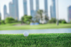 Day of golf. Golf ball is on the tee for a golf ball on the gree Royalty Free Stock Photos